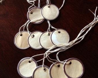 Set of 10 tea-stained metal rimmed paper tags.