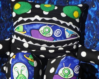 Alien Black Polka Dot Monster Pajama Eater - They Eat Toys and Remotes too - They also like to Cuddle and make a great Pillow.