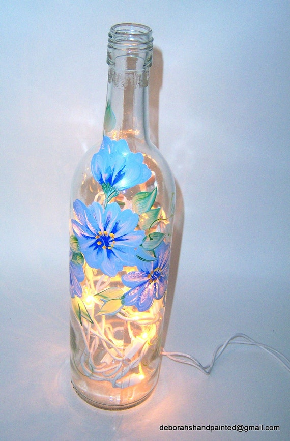 Items similar to wine bottle lamp hand painted blue white for Painting flowers on wine bottles