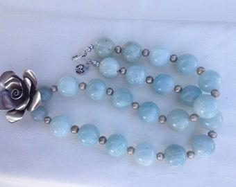 Aquamarine necklace with flower pendant