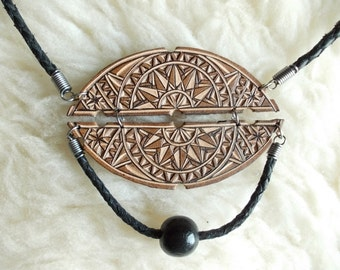 Hand carved leather necklace
