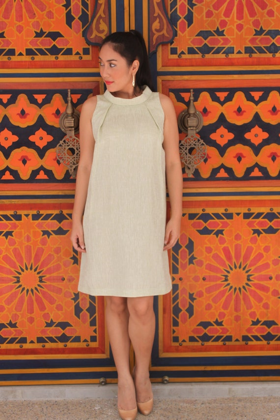 Style 4030 - Sleeveless dress in mint green lightweight linen with reversed rolled collar.