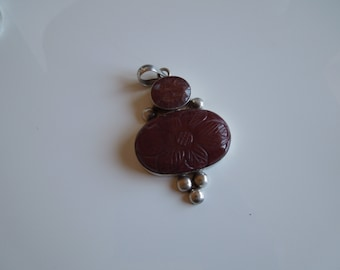 Large ruby and silver pendant.