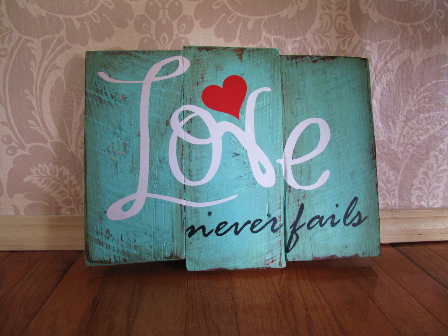 Distressed Wall Decor love never fails reclaimed wooden plank distressed wood sign