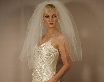 "wedding veil 2 layer elbow length 30"" long with pencil edging."