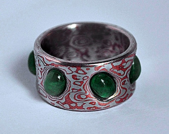 Ring mokume gane. Silver, copper and emeralds.