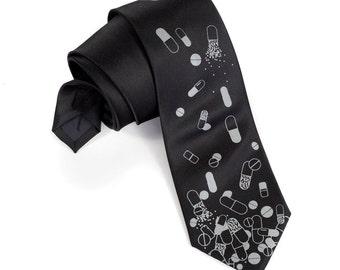 """Pill necktie. Men's tie. """"Pill Spill."""" Tumbling capsules, tablets, pills. Drugs, medicine necktie. Doctor gift, pharmacist gift, medic gift."""