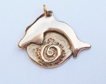 Dolphin pendant, symbolic pendant with eternity spiral, ocean life pendant in bronze