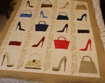 Fashionista Quilt with appliqued purses and shoes.