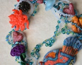 Coral Reef - polymer clay and seed beaded freeform necklace with a beaded micro mosaic fish