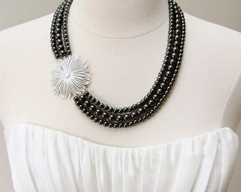 Polished to Perfection. Vintage Enamel Flower and Hematite Necklace.