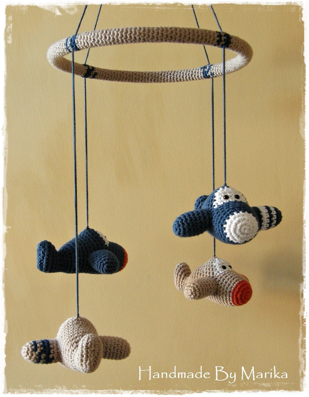 A baby mobile is a toy-like object that either attaches to your child's crib (on the side) or is ceiling mounted. It generally moves slowly, has baby-friendly figures attached to it, and it plays soft, sweet tunes at nap and bedtime.