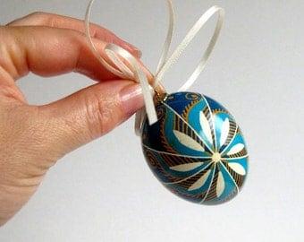 Blue pysanka egg traditional windmill patters
