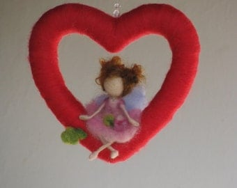 Waldorf inspired needle felted mobile - fairy sitting on a heart