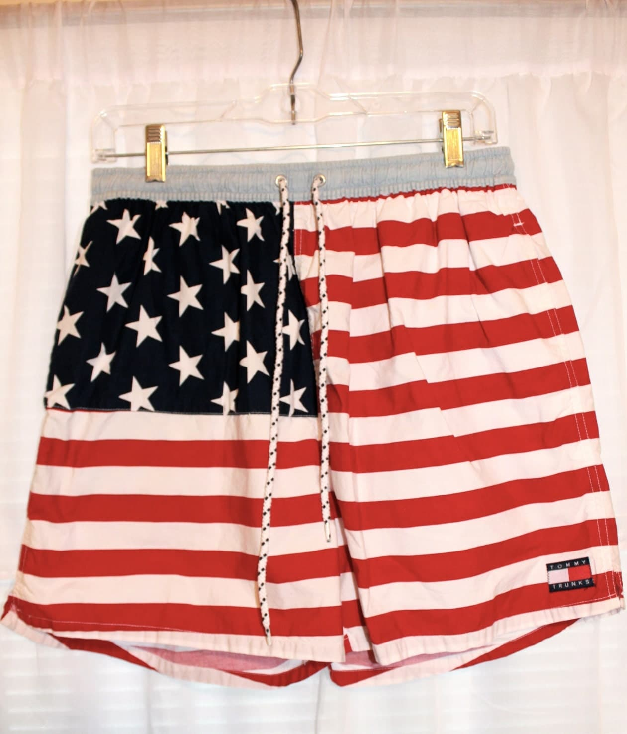 Show your American pride with these Men's Flag Swim Trunks. They feature an American flag pattern. These elastic waist swim trunks have a drawstring closure in the front and two side pockets for your convenience. They are available in a variety of sizes/5(12).
