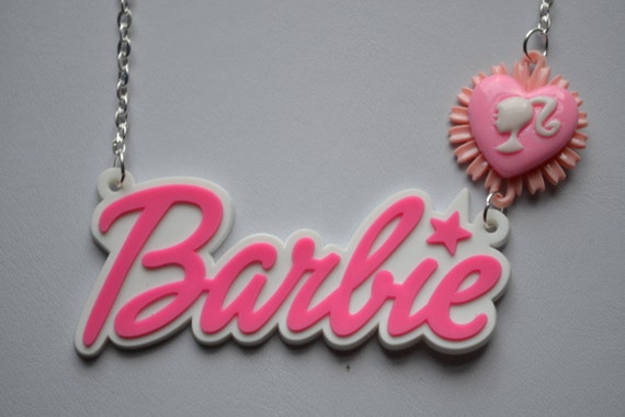 Items similar to big barbie logo and heart flower barbie head necklace