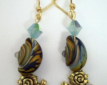 Lampwork snail earrings in earthy colors, brass snail dangle, genuine Swarovski crystal, golden handwrapped ear wires: Snailworks