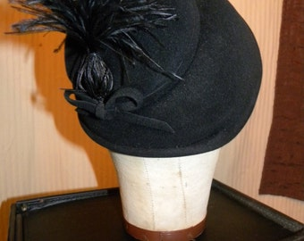 Beautiful Black Felt Cap with Dramatic Feather Decoration