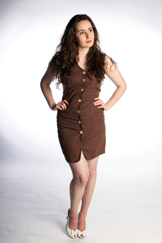 womens vintage indie dark brown dress size small with big front pockets and wooden buttons