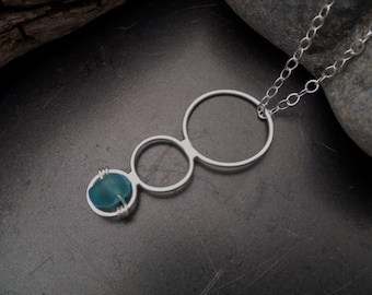Sea glass jewelry,  Blue sea glass accents a three circle pendant with modern lines