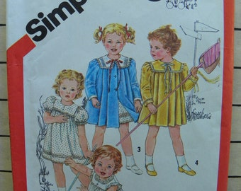 Toddle over here cutie pie - Toddlers dress and coat pattern from Cinderella for Simplicity 5864