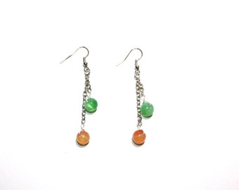 Dangle earrings in orange and green, with silver toned chain and findings