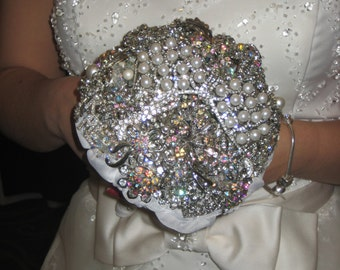 Brooch  Bouquet of Silver and white .