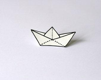 White plastic paper boat brooch