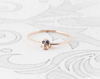 14K Rose Gold Moving Skull Ring with Sapphire Eyes