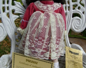 Collectible Porcelain Doll by Mann