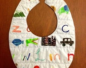 RESERVED FOR JENNY: light blue alphabet quilted reversible baby bib