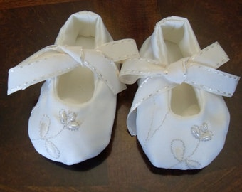 Off white satin baby shoes with pearls and satin ties