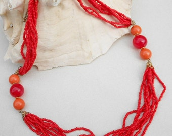 Vintage beaded necklace in orange marbled and melon glass and lucite 1980s