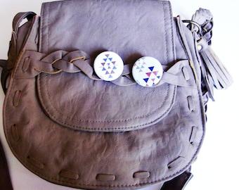 2 blue pattern badges