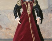 Elizabethan-Style Doll Wearing Red Velvet Gown, c. 1560-1575