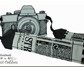 Camera strap, newspaper, black & white