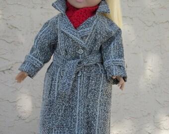 """Black & white long coat for an 18"""" doll."""