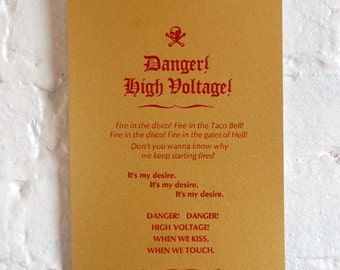 """Electric Six handset letterpress broadside of """"Danger, High Voltage."""""""