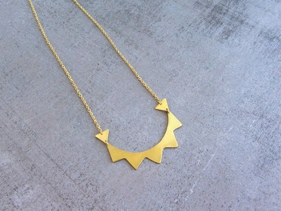 Long gold brass tribal circle necklace with aztec geometric triangles and spikes.