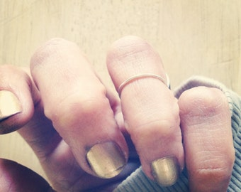 the simplest sweetest whisper of a ring - a midi ring