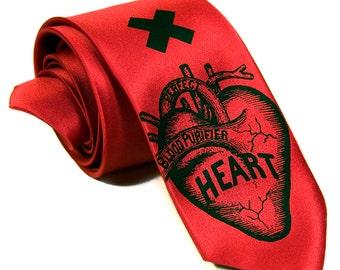 "Red anatomical heart narrow tie. ""Heart Attack"" screenprinted necktie. Black print."
