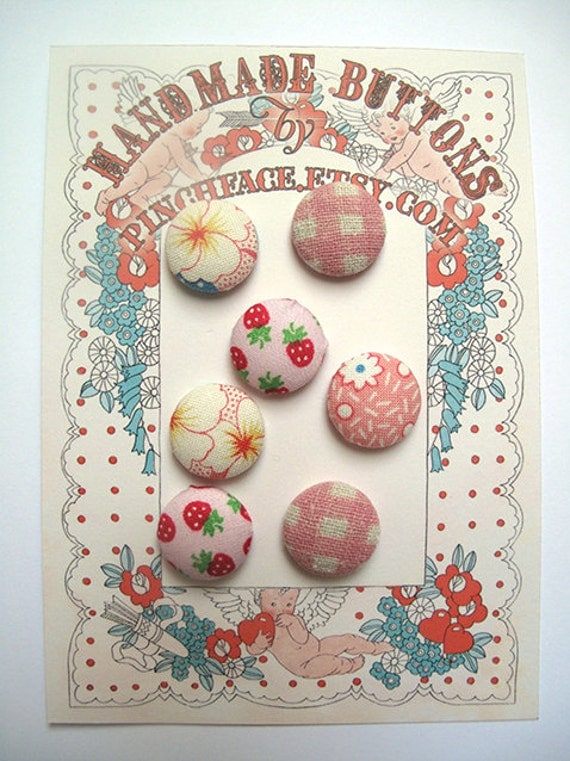 Fabric covered button set for sewing supplies. Shades of pink