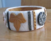 Cuff Bracelet with White Black Gold Designs Added
