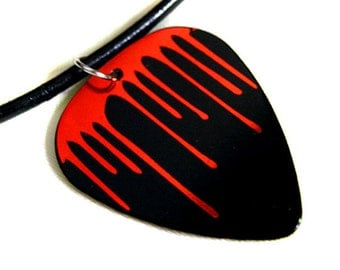Drips guitar pick necklace, black and red