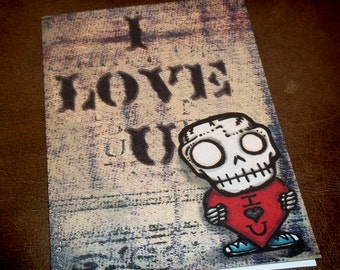 "Cute Skull Valentine's Day  ""The Kiss"" Love Card Romantic  5x7 Greeting Card Blank inside by Agorables Ruler of the Undead"
