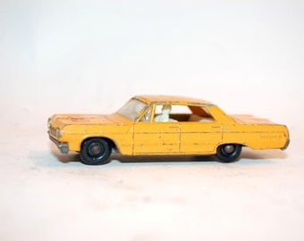Matchbox Taxi No. 20 Chevrolet Impala  Yellow Body ,white Interior, black plastic wheels 1964 Lesney products & Co Ltd