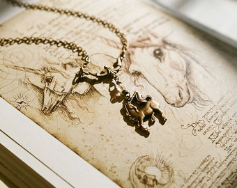 Magical unicorn lavalier necklace in antique brass