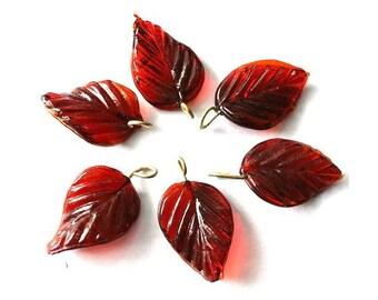 7 Vintage glass dangling beads leaf shape red brown , 27mm X15mm
