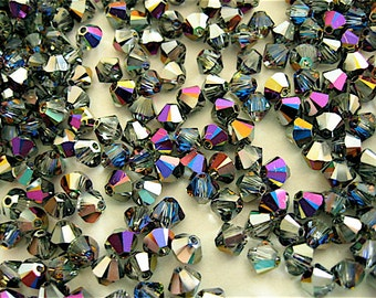 24 Crystal Heliotrope Swarovski Beads Bicone 5328 4mm