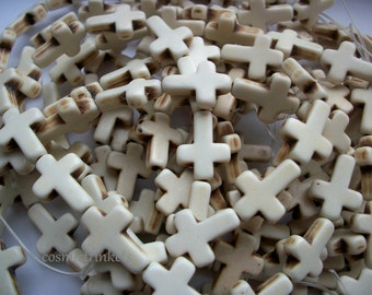 20 White/Cream Stone Cross Beads
